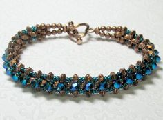 Metallic Crystal Bracelet Pattern.   This bracelet is larger, heavier and more substantial than my Chic Tennis Bracelet. Two needle cross-weaving lays the foundation for this bracelet. Sounds scary, but it's easier than you think! Project only takes about 2 hours to complete.
