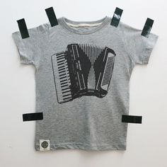 A personal favorite from my Etsy shop https://www.etsy.com/il-en/listing/474443712/sale-accordion-musical-tee-infant