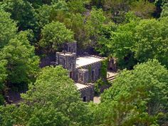 Most People Don't Know These 7 Castles Are Hiding In Oklahoma - 7. Collings Castle- Davis, OK: When visiting Turner Falls, look for the partially, abandoned castle nestled in the trees.