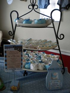 """Tiered trays hold the baby booties and candy-pretzel """"lollipops"""" that I made for baby shower."""