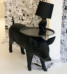 oh my goodness how cute!  rabbit lamp on top of a pig table!