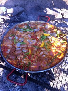 Cooking paella over an open fire.  Blue Mountains, Oregon