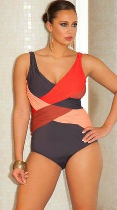 The pattern play on this suit creates a waist. Figure friendly and pretty too. Infinity Blu Phoenix Crossover Swimsuit at Swimsuitsforall.co...