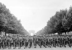 American troops of the 28th Infantry Division march down the Avenue des Champs-Élysées, Paris, in the `Victory' Parade. August 1944
