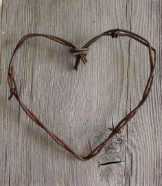 "DIY barbed wire heart. I would add ""L+K"""