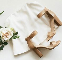 Style: Harlod Brand: Verali Colour: Beige and Black  White roses, white background, simple, chic, and sexy heels.