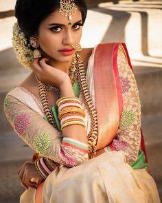 South Indian bride. Gold Indian bridal jewelry.Temple jewelry. Jhumkis.Cream white and pink silk kanchipuram sari.Braid with fresh jasmine flowers. Tamil bride. Telugu bride. Kannada bride. Hindu bride. Malayalee bride.Kerala bride.South Indian wedding. Pinterest: @deepa8
