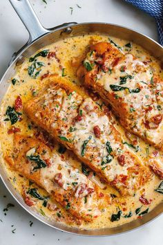 salmon recipes Creamy Garlic Tuscan Salmon With Spinach and Sun-Dried Tomatoes - - Smothered in a luscious garlic butter spinach and sun-dried tomato cream sauce, this Tuscan salmon recipe is so easy, quick, and simple. Healthy Salmon Recipes, Fish Recipes, Seafood Recipes, Dinner Recipes, Cooking Recipes, Tilapia Recipes, Cake Recipes, Healthy Food, Healthy Foods