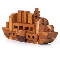 Tactile, 3D puzzles in organic materials - incredibly valuable in a child's learning experience.  The Boat Puzzle - Monkey Pod Games