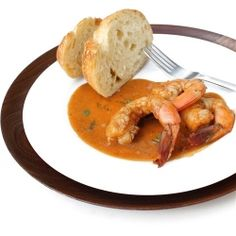 Cajun-style shrimp in a spicy sauce flavored with garlic, fresh rosemary, lemons, pepper sauce, and beer