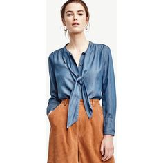 Ann Taylor Petite Chambray Tie Neck Shirt ($70) ❤ liked on Polyvore featuring tops, blue hyacinth, blue top, button front shirt, long sleeve chambray shirt, blue long sleeve shirt and petite shirts