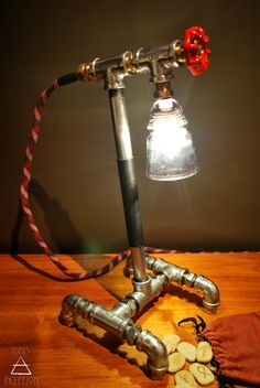 The Genesis lamp. A timeless heirloom, forged from polished iron and copper. Ambient light seeps through the vintage power insulator lampshade. Desk Lamp, Table Lamp, Living Vintage, Steampunk Lamp, Pipe Lamp, Power Led, Industrial Lighting, Glow, Lights