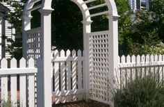 4 Foot 1 x 4 Picket Fence and gate with Arbor Stained White installed by A. Anastasio Fence Company.