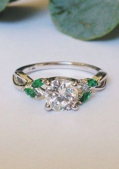 marquise emerald buds in trellis ring.