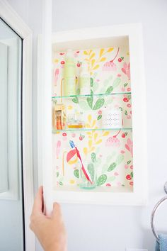 Add a splash of color to your medicine cabinet with peel-and-stick wallpaper.