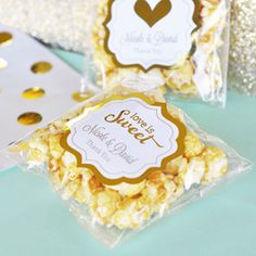 """Memories of your special day will continue to """"POP"""" up in your guests' minds with every bite of these Personalized Metallic Gold & Silver Foil Caramel Popcorn favors. Each bag comes with a shiny metallic gold or silver foil label with your Edible Favors, Edible Wedding Favors, Unique Wedding Favors, Wedding Ideas, Wedding Decor, Popcorn Favors, Candy Favors, Wedding Bubbles, Wedding Planning On A Budget"""