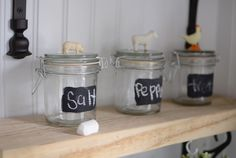 Denise's craft workshops include projects with farm animal figurines, such as key chains, necklaces, and these canning jars with chalkboard labels that are on display inside the camper.