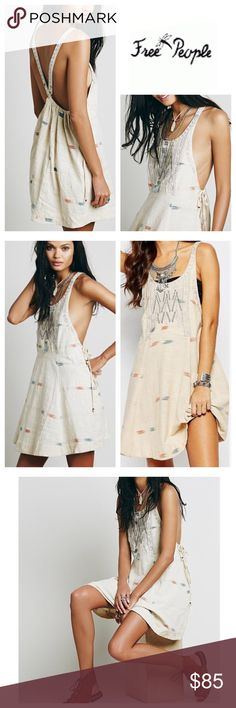 """Free People Beige Mini Dress Free People Arizona mini dress. Scoop neckline with detailed embroidery at front. Thin straps that form a V back with embroidered detail. Dropped armholes with cinched bow detail. Hidden side seam pockets. Brushed print placed throughout. Approx Length from shoulder to hem: 36"""" 100% Cotton. Hand wash. Color;  Tea Combo Free People Dresses Mini"""