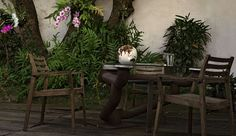 Relaxing in the garden. Globe by French designer Bruno Helgen.