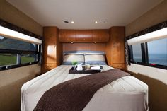 Another industry first on a non-slide 24' coach, the U24IB features a walk-around island bed. Ample wardrobe space is found on either side of the bed, as well as in the overhead cabinets above. Extra storage can be found underneath the bed.