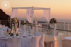 Bespoke luxury decoration for the wedding of Miss Christel Atallah and Mr. Eddy Asmar, celebrated in Santorini the 8th of September 2013.  Reception venue: Rocabella Hotel, Imerovigli