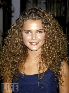 Sure, everyone knows the story of Keri Russell cutting off her beautiful hair and thus sabotaging her entire career. But when was the last time you actually took a look at these voluminous locks? We're talking some seriously magical curls.  R.I.P., little ringlets. We'll never forget you. Maybe we'll even buy Felicity on DVD.  See more: Drastic Celebrity Transformations, also featuring Mickey, Axl and Ferris Bueller's sister.