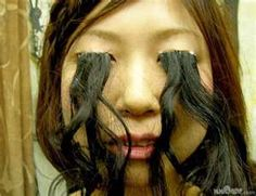 Weird & Bizarre Image: Your eyelashes can be *too* long, ladies.