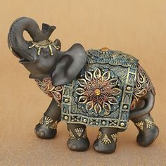 Mahogany Brown Elephant With Colorful Headdress And Blanket - Large Size- Bring the mystique of the East into your home with a magnificent ornate elep Elephant Sculpture, Elephant Art, Elephant Gifts, Elephant Centerpieces, Mahogany Brown, Elephant Figurines, Animal Sculptures, Flower Designs, Hand Painted