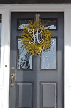 TO DO: Black front door, cute yellow wreath and welcome applica!