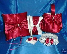 Apple Red Flower Girl Basket Pillow,Guest Book,Pen, and Garter.  THESE LOVELY ITEMS ARE AVAILABLE IN MY STORE ON EBAY  PLEASE SEE GIDESIGNS  OR KRINGLE3 FOR ALL MY CUSTOM MADE ITEMS IN THE COLORS OF YOUR CHOICE TO MAKE YOUR WEDDING DAY SPECIAL AND UNIQUE.