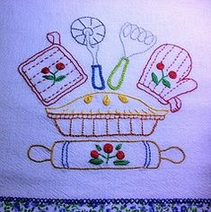 Kitchen utensils embroidered on a dish towel.