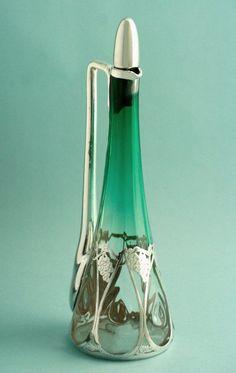 This seems like the prize-winner to me. Silver Overlay Art Nouveau Decanter - Marks for the LaPierrre Silver Workshop of New York and Newark, NJ circa 1900 Jugendstil Design, Modernisme, Art Decor, Decoration, Art Nouveau Design, Glass Ceramic, Objet D'art, Vases, Antique Glass