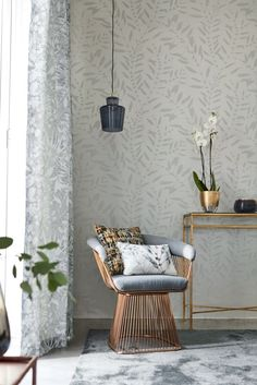 An all over serene leaf trail wallpaper design picked out in tiny shimmering beads that catch the light.