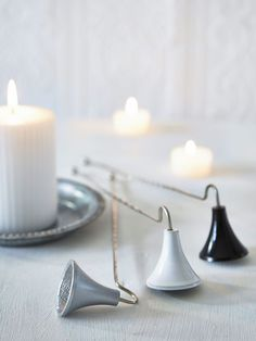 Swedish Candle Snuffers - love the white one!