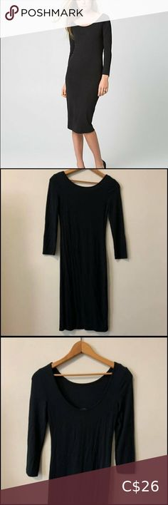 Babton Aritzia jet black fitted stretched dress Babton Aritzia jet black fitted stretched dress. In excellent condition. Deep round back neck. Very sexy and elegant at the same time. Size is XXS but fit small to XS so listed as that. Ask if have any other questions. Bundle for saving and for reduce shipping cost. Aritzia Dresses Long Sleeve Maxi, Maxi Dress With Sleeves, Jet, Silk T Shirt, Deep V Dress, Bustier Dress, Silk Slip, Fit Flare Dress