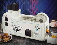 Mini Donut Factory / The Mini Donut Factory automatically forms, fries and drains delicious mini donuts in approximately 90 seconds. http://thegadgetflow.com/portfolio/automatic-mini-donut-factory/