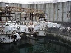 The set of James Cameron's The Abyss 20 years later: An abandoned nuclear power plant in South Carolina exposed to the elements -- OPENPICS. Abandoned Film, Abandoned Buildings, Abandoned Places, Abandoned Property, Abandoned Mansions, Desert Places, Nuclear Power, Brutalist, Urban Decay