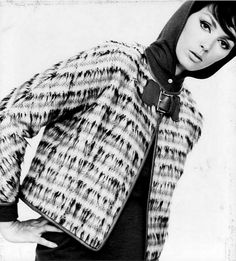 1962 Lucinda in a patterned shaggy wool jacket with leather piping and buckle closure worn over a hooded wool jersey sheath by Bonnie Cashin