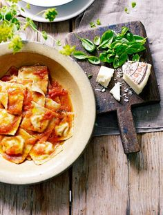 Wholewheat ravioli with courgette flowers  ricotta in a simple tomato sauce.  Jamie Magazine