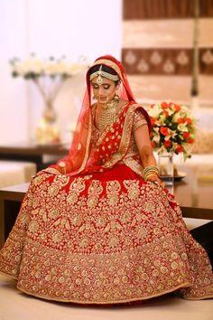 Bridal Lehengas - Gold and Red Wedding Lehenga | WedMeGood | Red Bridal Lehenga with Gold Jewelry and Double Net Dupatta  #wedmegood #indianbride #indianwedding #lehenga #bridal #gold #red