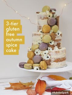 3 tier gluten & dairy free autumn cake with naked cream 'cheese' frosting, a cascade of macarons, gingerbread autumn leaves and edible flowers