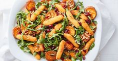 Dried cranberries add a touch of sweetness this roast sweet potato and crumbed chicken salad.