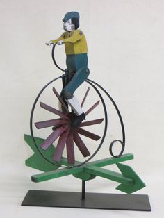 http://www.liveauctioneers.com/item/22983650_folk-art-high-wheel-bicycle-with-rider-whirligig-in