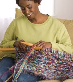 Interesting idea to make rugs and use up lots of yarn! You make the giant needles from dowels.