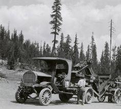 Trucks pulling heavy equipment at Crater Lake National Park, Oregon - ca. 1921