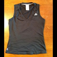 Black Adidas tank in size medium. Very cute adidas v neck tank in size medium.  93% nylon and 7% spandex, super soft fabric.  Tank has been worn 1-2 times but is in excellent condition.  Top of shoulder to bottom of tank measures 21 1/2 inches. Adidas Tops Tank Tops
