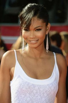 Super Model Chanel Iman looks beautiful with her messy bangs and cute ponytail.