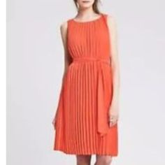 Dress cocktail casual orange coral pleated Great dress worn once. Flattering pleated coral orange lightweight chiffon belted dress. Great for maternity or pregnancy as well. Banana Republic Dresses Midi