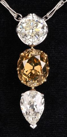 A Belle Epoque platinum, gold, diamond and coloured diamond pendant, circa 1910…