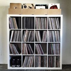 Look at all those records! I know someone who would go crazy to have a collection like that :)